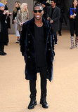 Tinie Tempah kept his shades on while arriving at the Burberry Prorsum show.