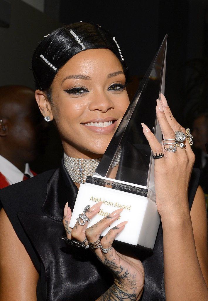 "Rihanna brought the ""doobie"" wrap outside the bedroom for the 2013 American Music Awards. Her wrapped style and pearl pins caused quite the controversy."