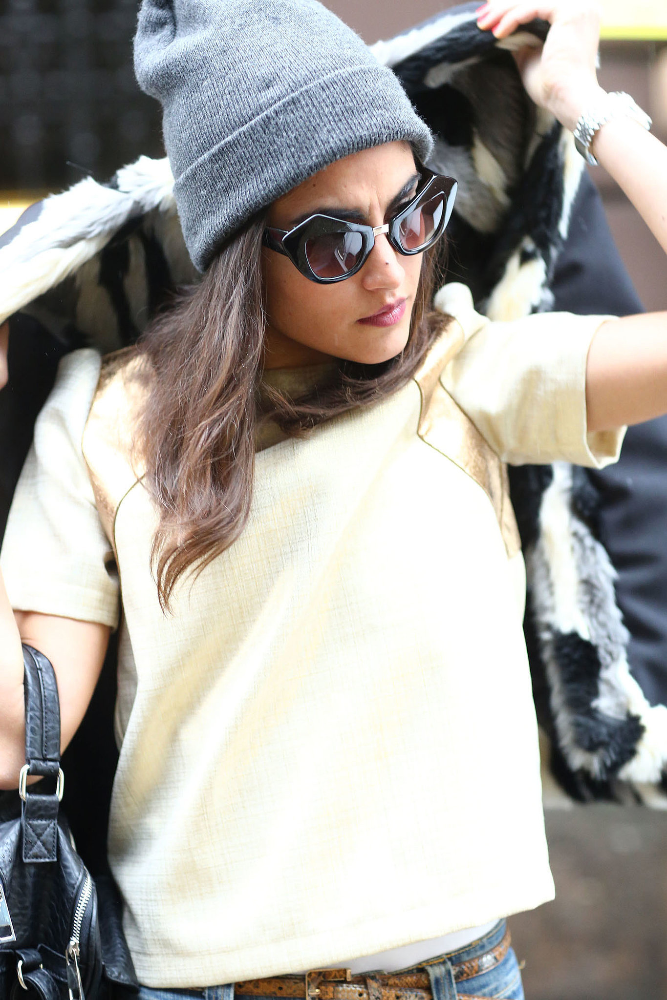 "Her beanie says ""cool girl"" — her sunglasses say &quot"