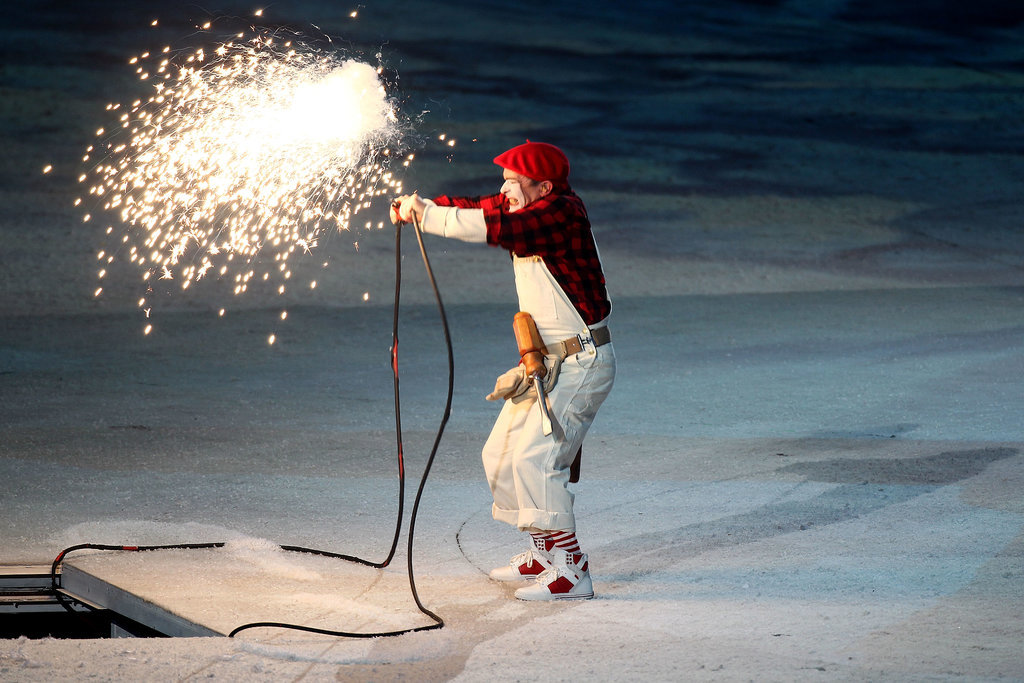 A mime performed before the Olympic cauldron was lit.