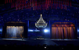 Two giant stages popped up in the middle of the arena, a chandelier hanging between them.