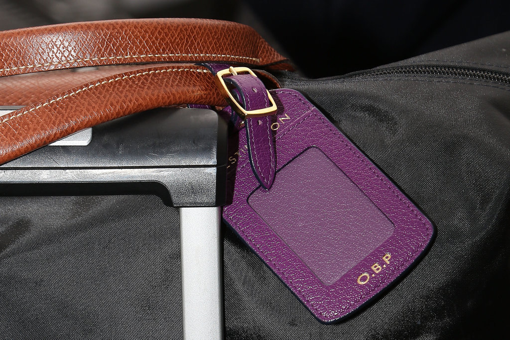 And of course, the style setter doesn't travel without monogrammed luggage tags.