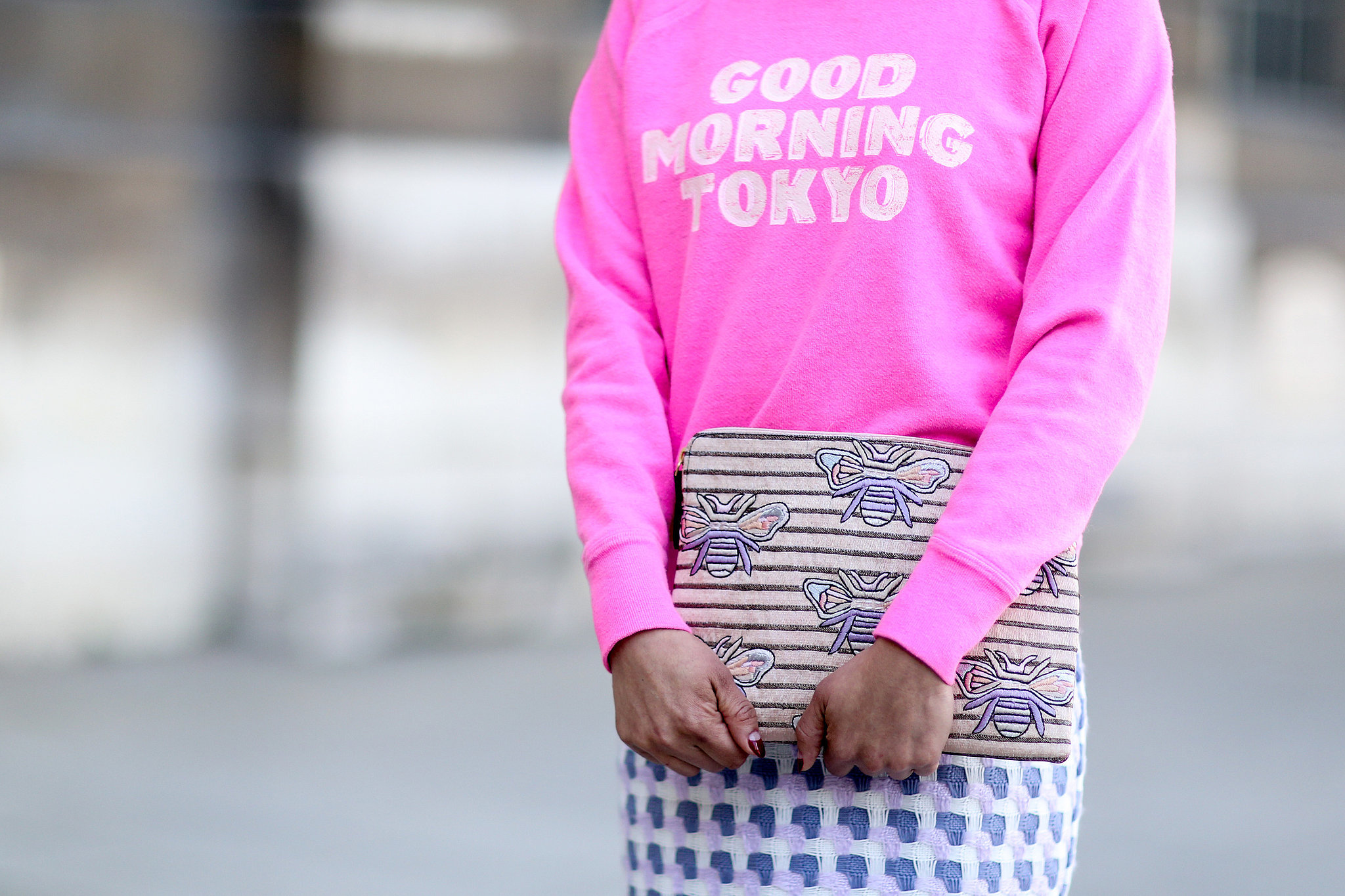 We love that her clutch pairs perfectly with more print.