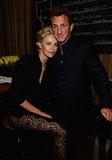 Charlize Theron cuddled up to Sean Penn at Pharrell Williams's pre-Oscars bash.