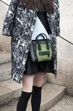 Another Celine to gush over, this time colorblock in black and moss green.