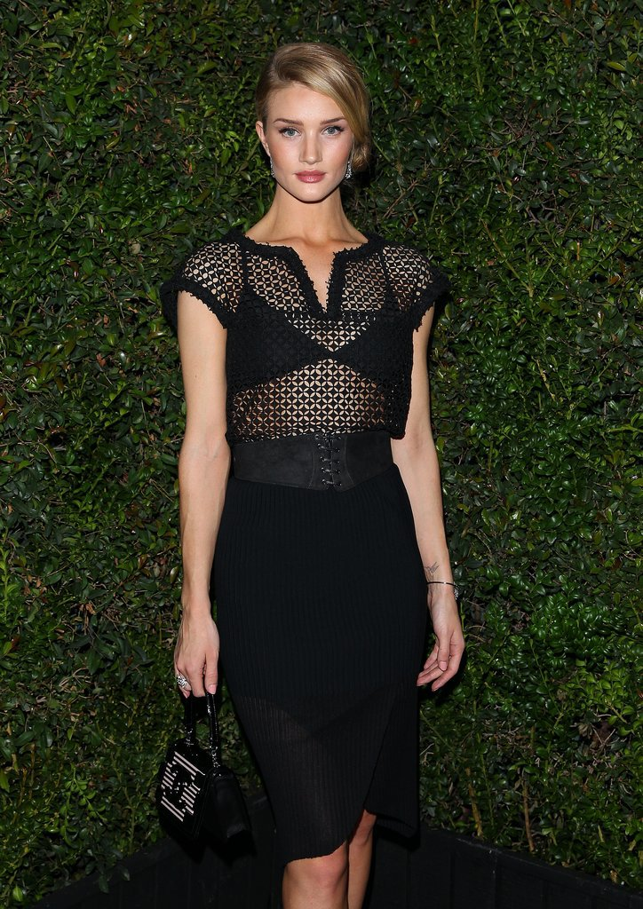 Rosie Huntington-Whiteley heated up the dinner with a sheer black dress.