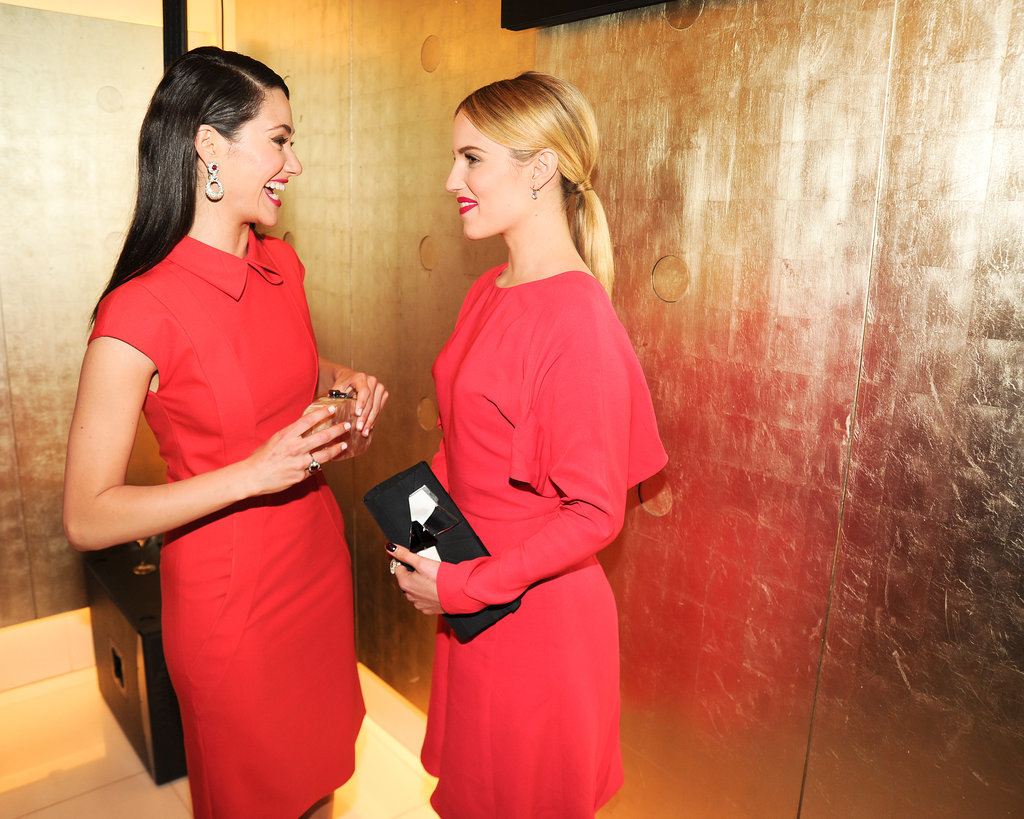 Dianna Agron said something to make Emmy Rossum laugh at the Giorgio Armani event on Friday.