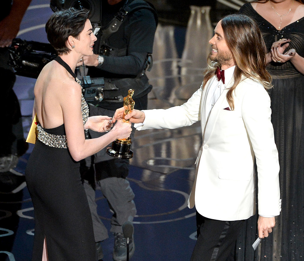 Anne Hathaway presented Jared Leto with his statue.