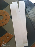 I cut poster board into strips 3 1/2 inches wide for the sides of the ampersand. Source: Happy Looks Good on You