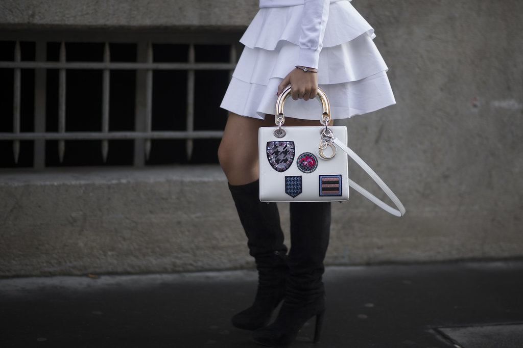 Talk about arm candy — this showgoer flashed a covet-worthy Dior bag.