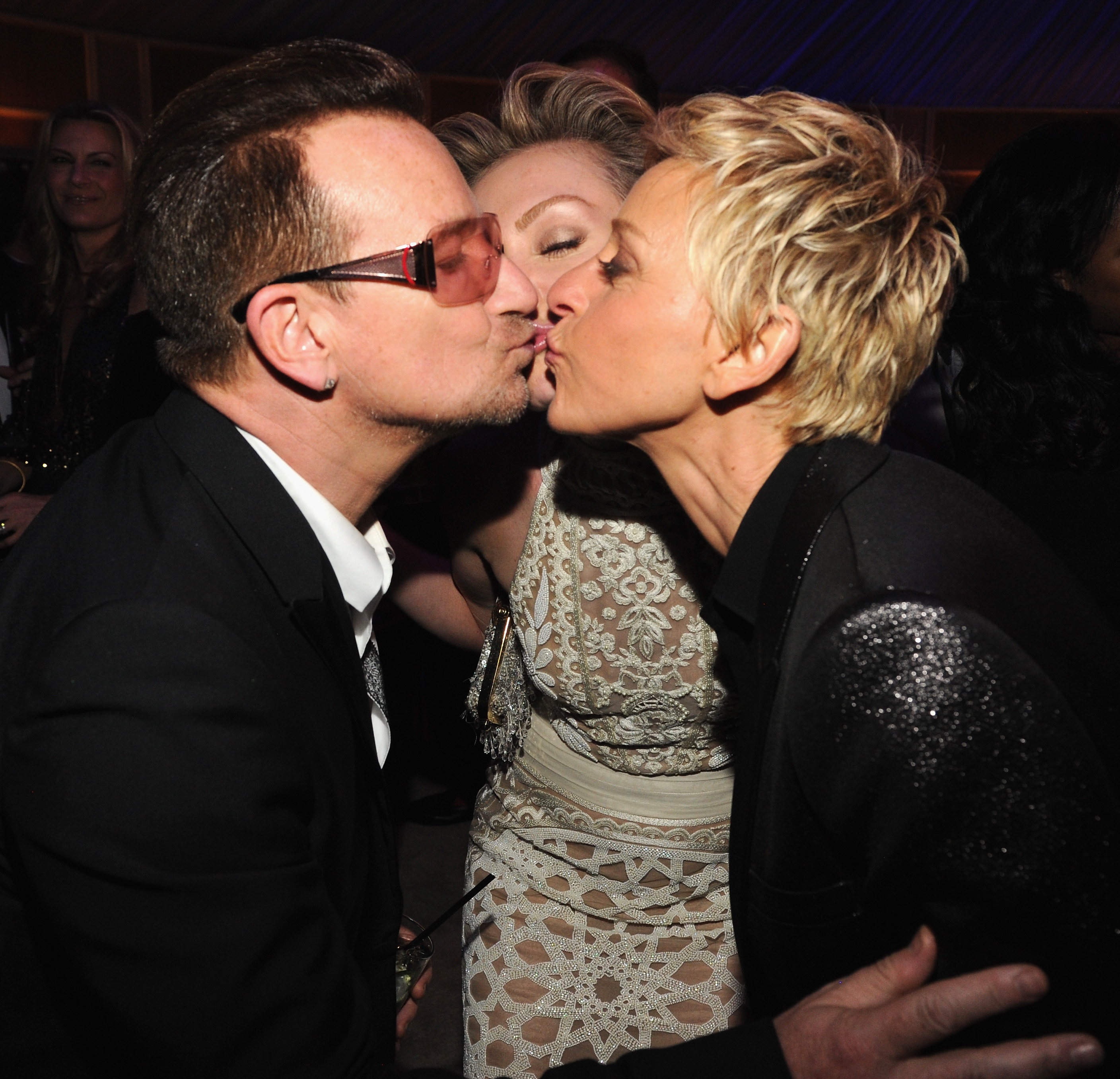Bono, Portia de Rossi and Ellen DeGeneres, at Vanity Fair's Oscars ...