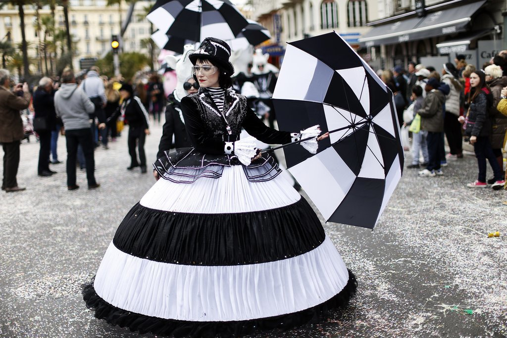 A reveler dressed up for Nice Carnival in the French Riviera.