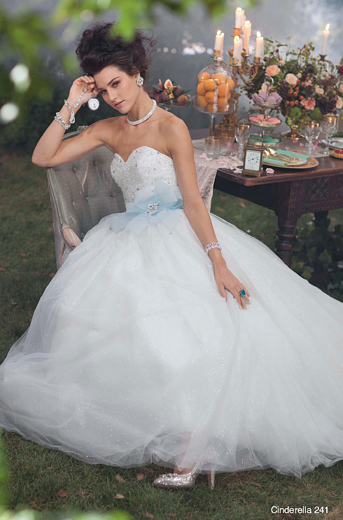 The Alfred Angelo Cinderella dress ($1,199) is a gauzy, shimmering confection with a pale blue belt. All it needs is the glass slippers!