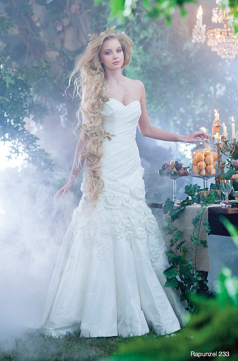 Alfred Angelo's Rapunzel gown ($1,199) twists around in a similar way as her braided hair, with organza and taffeta flowers wrapping around the skirt.