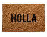 "Welcome guests to your home with this fun ""holla"" mat ($50). The playful piece will put a smile on your face whenever you come and go."