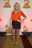 Carrie brightened her orange-and-navy colorblock Diane von Furstenberg skirt with gold Stella McCartney glitter pumps in January 2013.
