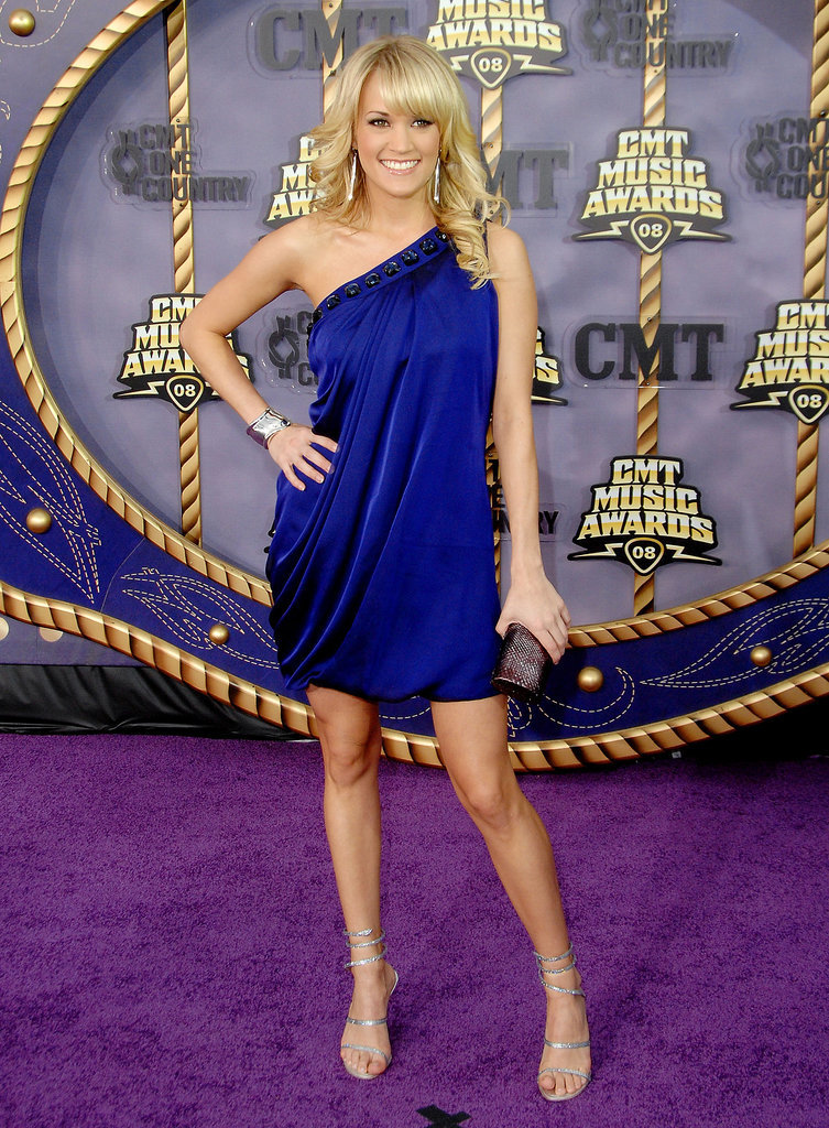 The singer posed in a regal purple mini and delicate ankle-wrap sandals at the 2008 CMT Music Awards.