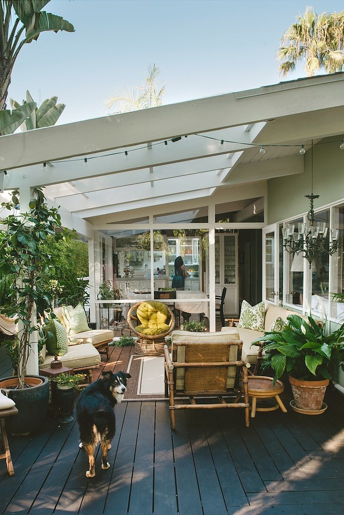 For this indoor-outdoor living room, green walls were used to create a seamless transition onto the patio.  Photo by Sargeant Photography via Style Me Pretty