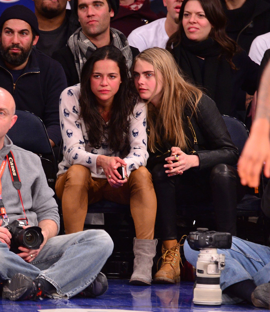 Cara Delevingne leaned up against Michelle Rodriguez when the Detroit Pistons played the New York Knicks in January.