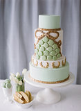 Let them eat (green) cake! Finished with macarons, this dessert is a reception standout.  Photo by  Katie Parra Photography via Style Me Pretty