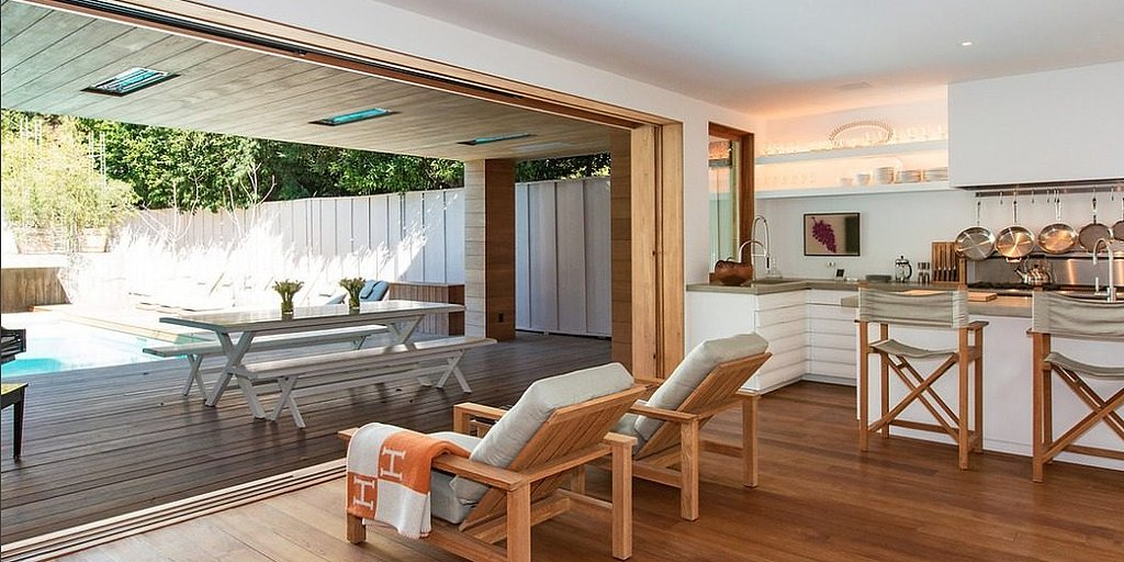 Another view of the home's open floor plan leading onto the deck.  Source: Chris Cortazzo