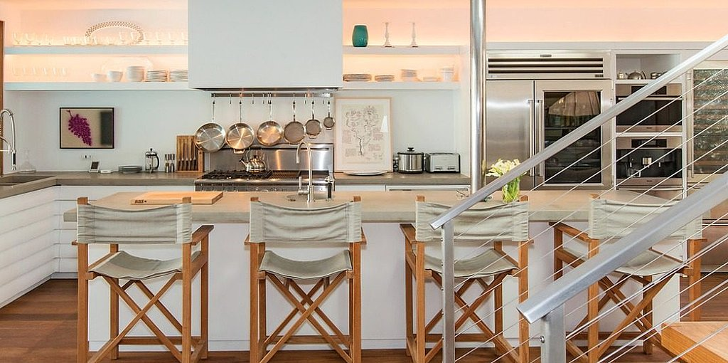 The open shelving and casual bar chairs give the kitchen a modern, beachy vibe.  Source: Chris Cortazzo
