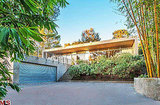 Situated up a gated driveway, the house sits on a lush, flat lot.  Source: Redfin