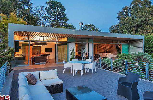The vast deck above the garage offers plenty of outdoor living space.  Source: Redfin
