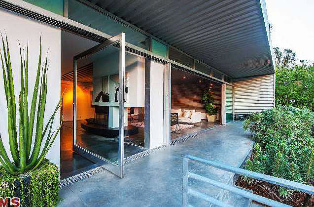 A glass front door offers optimal views of the property.  Source: Redfin