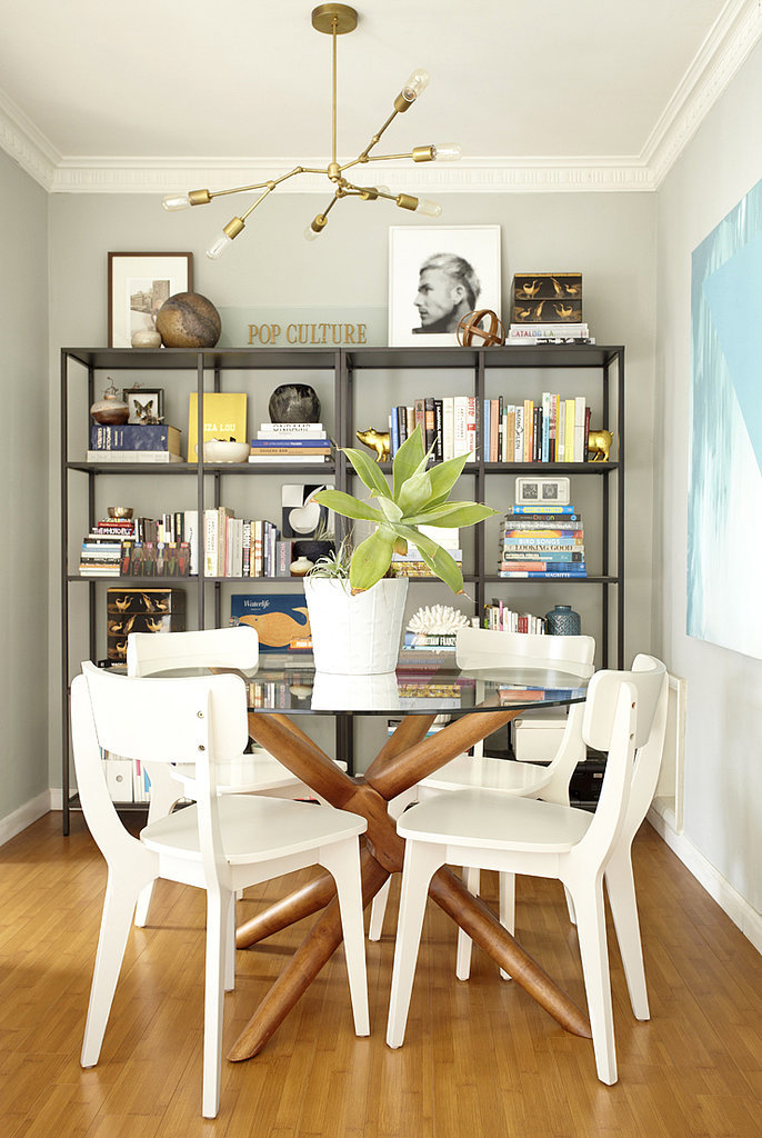 The midcentury modern table and chairs make a statement without ...