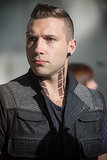Eric (Jai Courtney) has some serious facial jewelry.