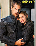 Four and Tris hold each other close.