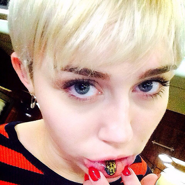 Miley Cyrus got the sad kitty emoji tattooed on her lower lip. Source: Instagram user mileycyrus