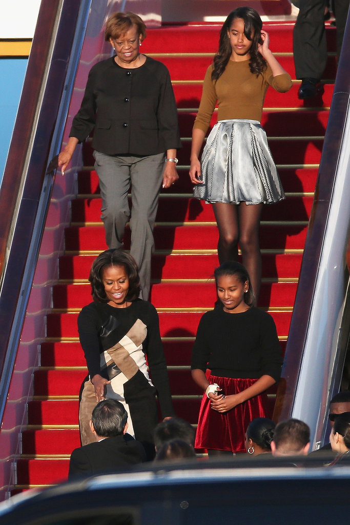 Malia and Sasha Obama coordinated in skirts and tights while traveling.