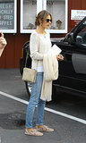 Even if it was the middle of Winter, Alessandra Ambrosio's outfit looked like it was ready for Summer! She paired a loose cream sweater with roomy jeans and flat Soludos.