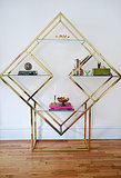 "When Casey stumbled upon this rare brass étagère shelving unit in pristine condition, she pounced on it. ""It was great to accessorize!"" said Casey.   Source: Homepolish"