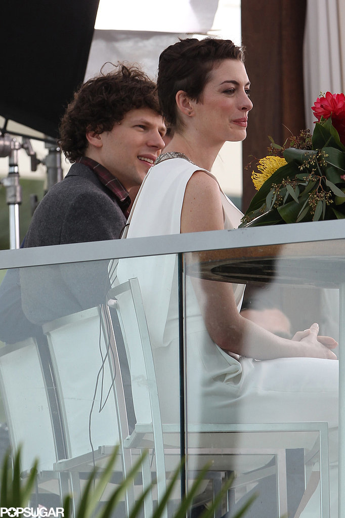 She sat with costar Jesse Eisenberg.