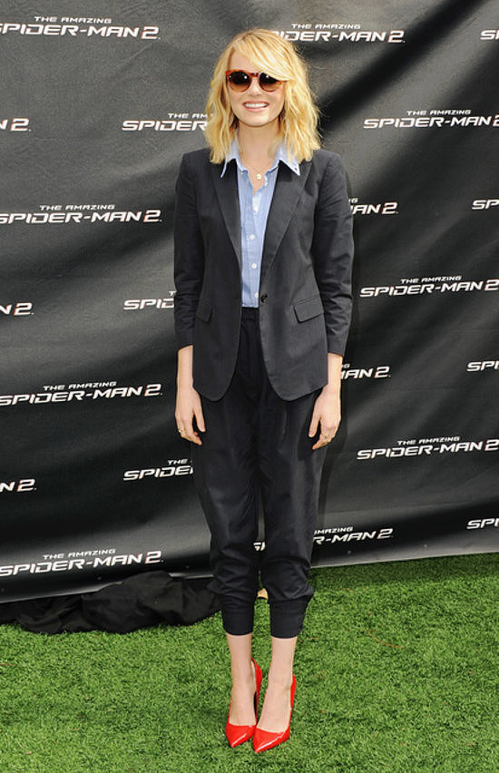 How does a girl put her mark on menswear? If you're Emma Stone, you do it with a hot pair of red Kurt Geiger heels.