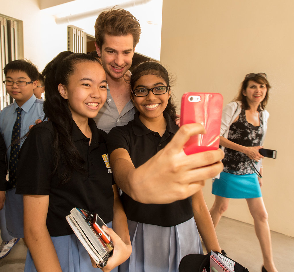 Andrew snapped selfies with fans.