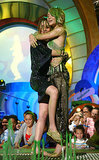 Mary-Kate and Ashley Olsen hugged as they got slimed in 2004.