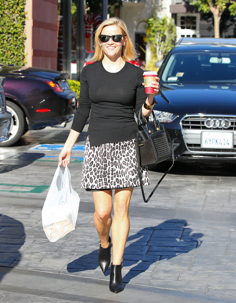 Reese Witherspoon in Leopard Skirt and Perforated Black Bag