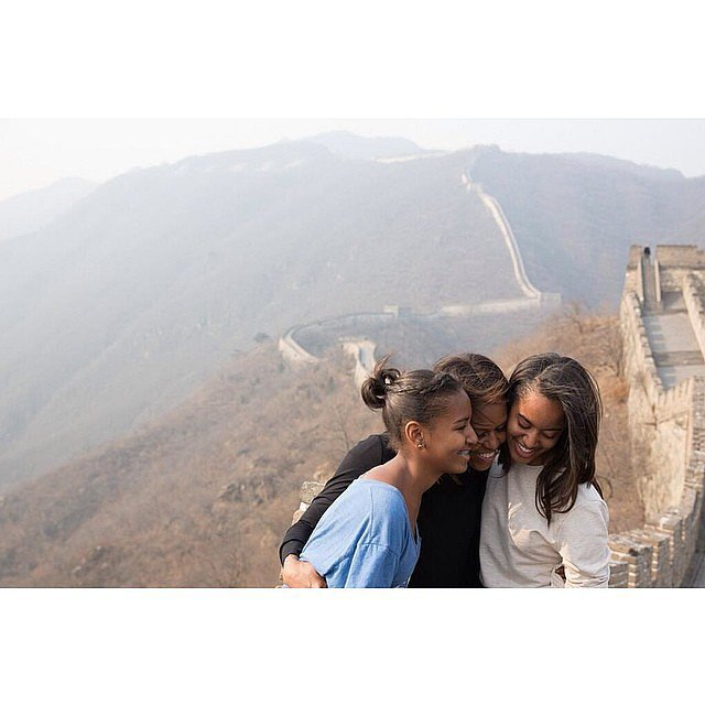 First Lady Michelle Obama shared a moment with her daughters, Malia and Sasha, on the Great Wall of China. Source: Instagram user michelleobama
