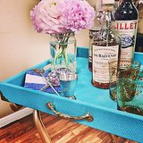 When you live in tight quarters, always look out for multipurpose furniture. A simple tray is a great example: it can be used as a side table, nightstand, or in this case, bar cart. And making one yourself is way easier than you'd think!  Source: Lily Shop