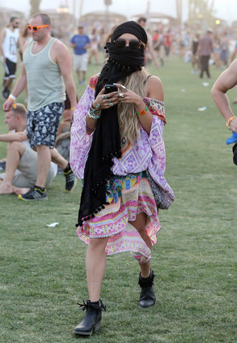 Vanessa Hudgens covered up with a scarf.