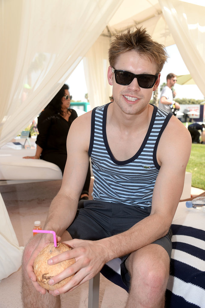 Chord Overstreet sipped on a tropical drink.