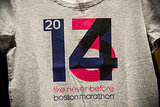 "A t-shirt reading ""2014: Like Never Before"" was on sale at a nearby running apparel store."