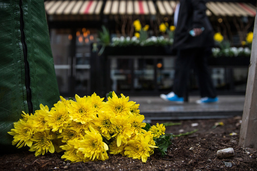 Flowers were set along the finish line of the Boston Marathon on the one-year anniversary of the 2013 bombing.