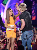 Ariana Grande high-fived Ross Lynch at the Kids' Choice Awards in March 2014.