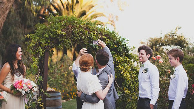 How to Kindly Keep Your Wedding a Phone-Free Zone