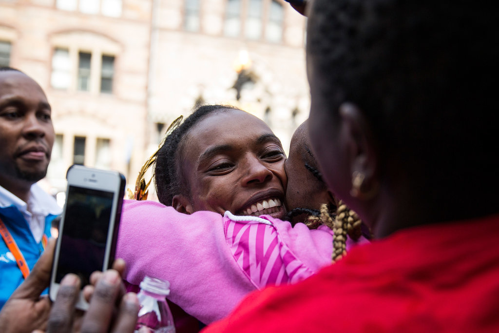 Rita Jeptoo hugged her family after winning the women's division of the Boston Marathon.